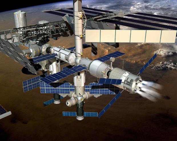 Concetto artistico della navicella cargo ATV-5 mentre frena la Stazione Spaziale Internazionale (Immagine ESA)