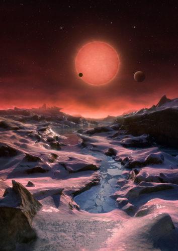 Concetto artistico della stella TRAPPIST-1 e dei suoi pianeti visti da uno di essi (Immagine ESO/M. Kornmesser)