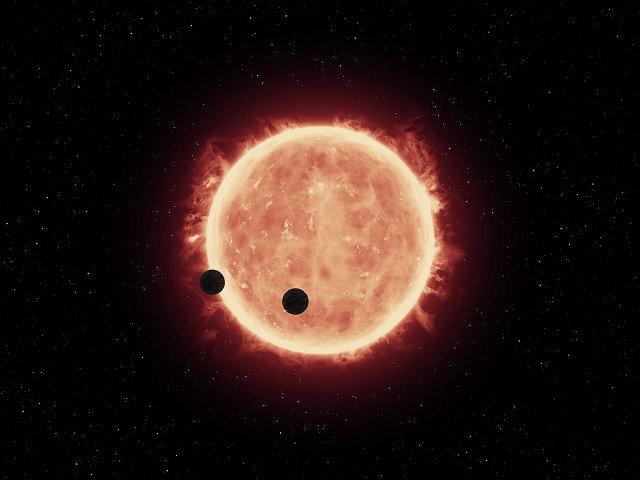 Concetto artistico di due esopianeti in transito di fronte alla stella TRAPPIST-1 (Immagine NASA/ESA/STScI/J. de Wit (MIT))