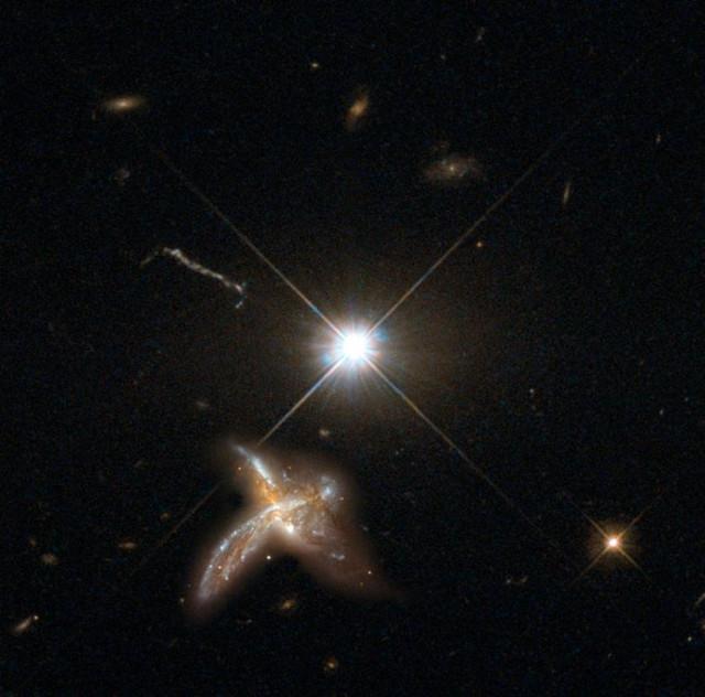 Concetto artistico di una fusione galattica vicina a un quasar (Immagine MPIA con materiale di Nasa/Esa Hubble Space Telescope)