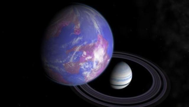 Concetto artistico di pianeta gigante gassoso con una luna abitabile (Immagine cortesia Andy McLatchie)