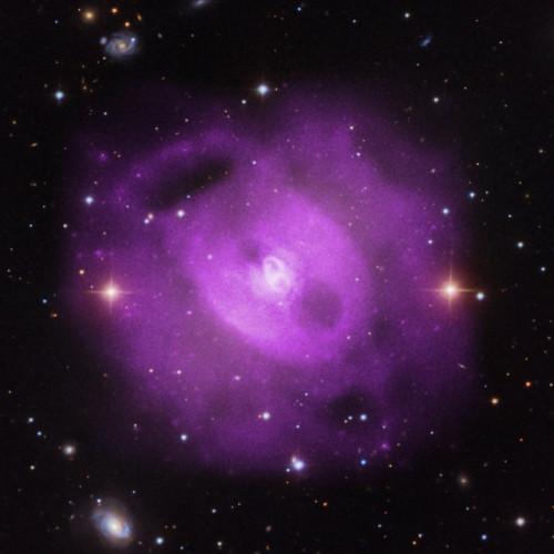 Il gruppo di galassie NGC 5813 visto dall'osservatorio per i raggi X Chandra (Immagine X-ray: NASA/CXC/SAO/S.Randall et al., Optical: SDSS)