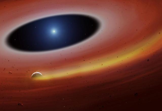 Concetto artistico di planetesimo in orbita attorno alla nana bianca SDSS J122859.93+104032.9 (Immagine cortesia University of Warwick/Mark Garlick)
